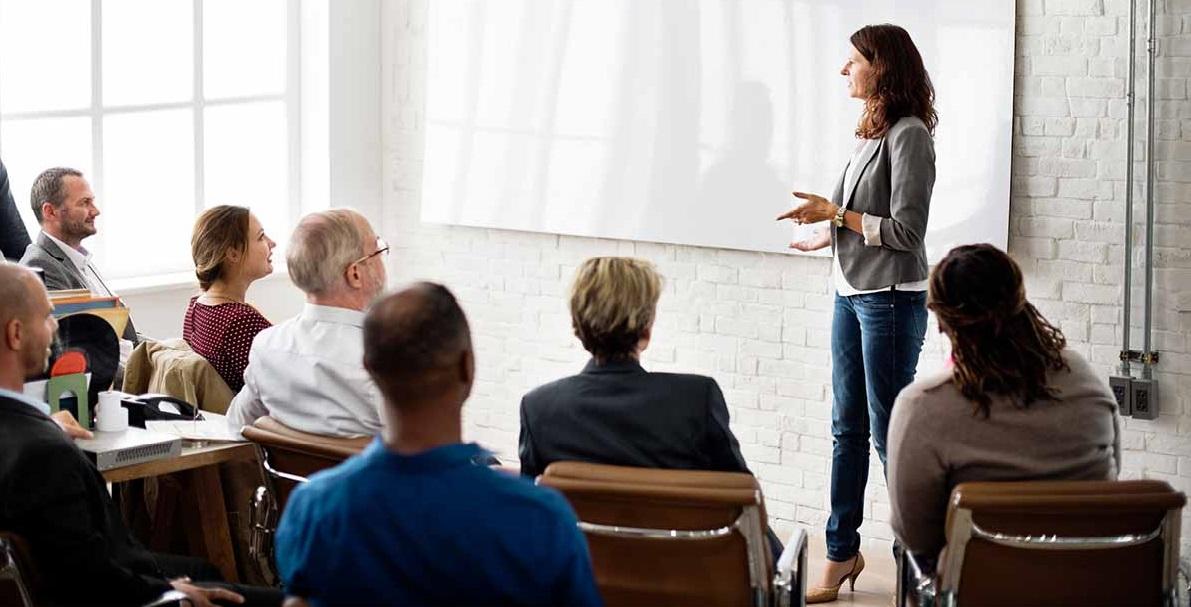 A woman teaching a Dynamics NAV class