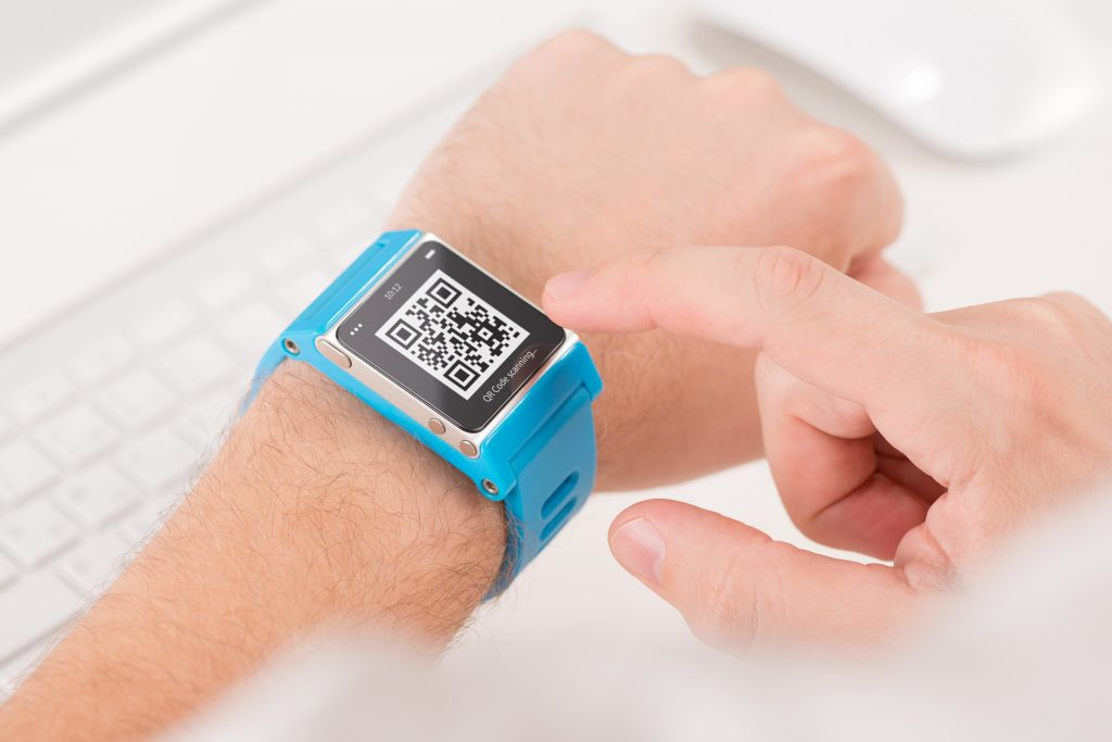 Man is scanning quick response code with blue smart watch